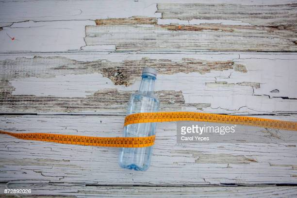 tape measure and fresh water on rustic brick surface