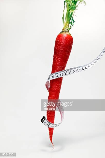 tape measure around standing carrot