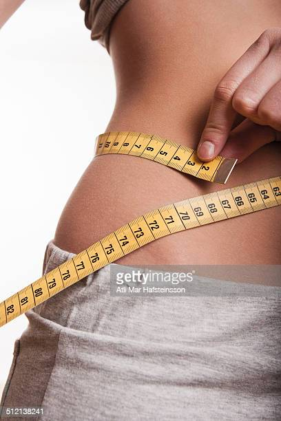 Tape measure around waist