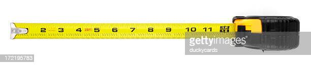 tape measure extended to one foot or twelve inches - inch stock pictures, royalty-free photos & images