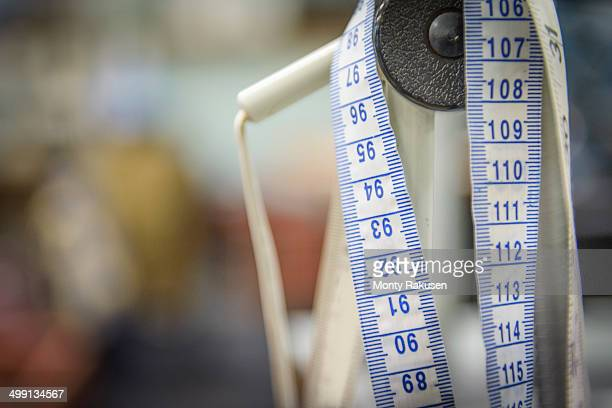 Tape measure in clothing factory, close up
