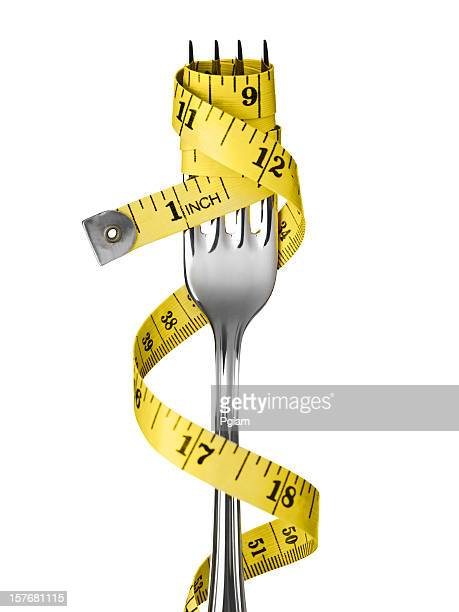 tape measure on a fork - measuring tape stock photos and pictures