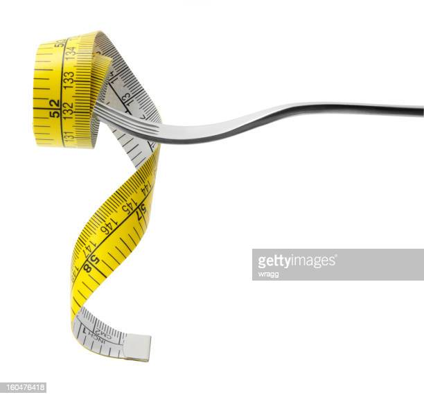 tape measure on a fork - centimetre stock photos and pictures
