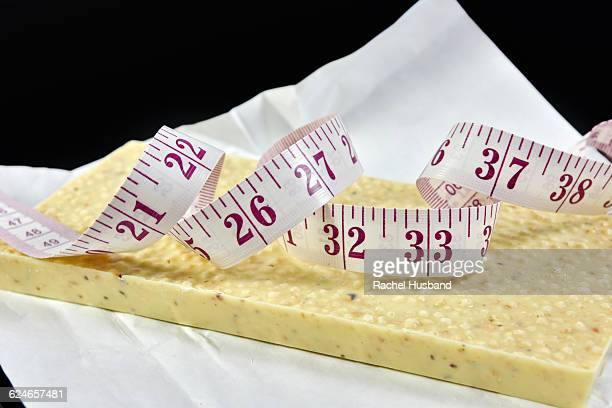 Tape measure on top of a white chocolate bar