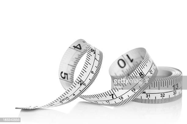 tape measure on white background - inch stock pictures, royalty-free photos & images