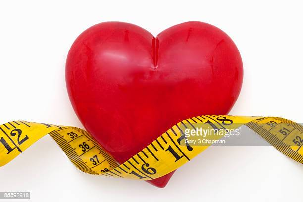 Tape measure over red alabaster heart