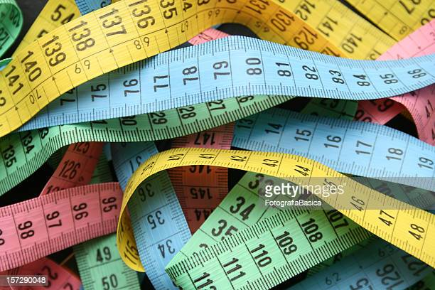 tape measures background - meter unit of length stock pictures, royalty-free photos & images