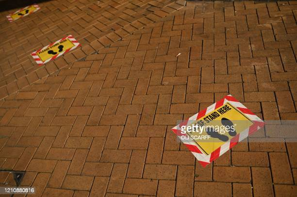 Tape on the ground is seen to help social distancing in a closed Bury Market in the town of Bury Greater Manchester northwest England on April 24...