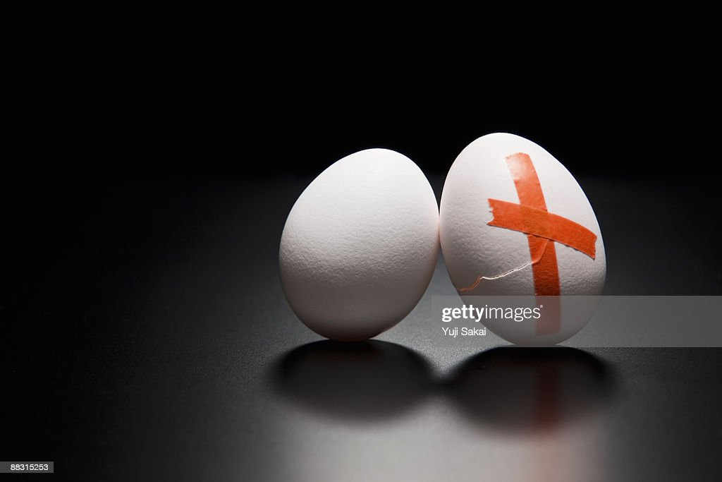 taped broken egg : Stock Photo