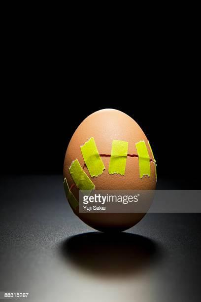 taped broken egg