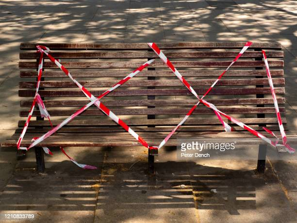 "Taped-off bench on the South Bank on April 21, 2020 in London, England. Taped-off benches and other ""social distancing"" markers have become common..."