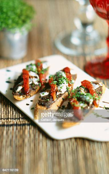 tapenade and anchovies on toast