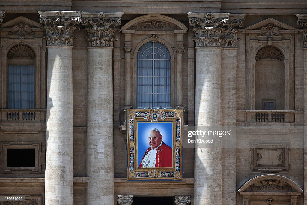 A tapestry depicting the late Pope John XXIII hangs on the balcony of St Peters basilica on April 25, 2014 in Vatican City, Vatican. The late Pope John Paul II and Pope John XXIII will be canonised on Sunday 27 April, inside the Vatican when 800,000 pilgrims from around the world are expected to attend.