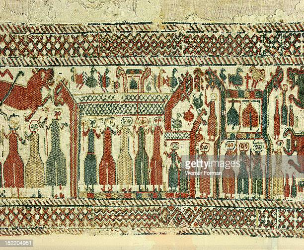 Tapestry detail illustrating the struggle between Christianity and paganism The three figures to the right are ringing bells to frighten away evil...