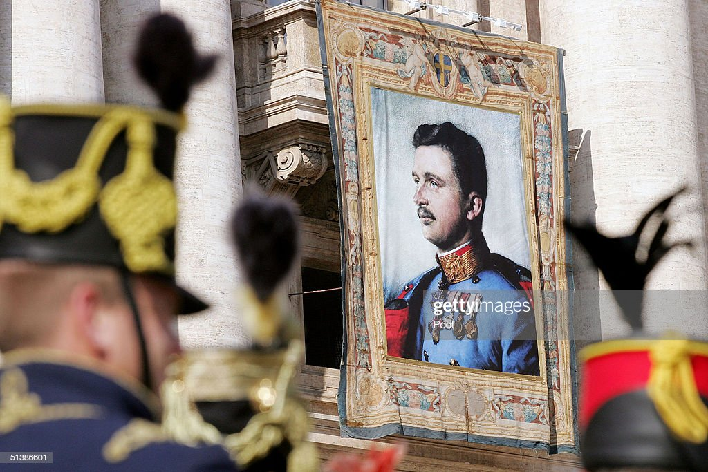 A tapestry featuring the portrait of Austria's last emperor, Karl I, hangs on a balcony overlooking the altar in St. Peter's Square October 3 , 2004 in Vatican City. Pope John Paul II named five Catholics on the road to sainthood, including Karl I.