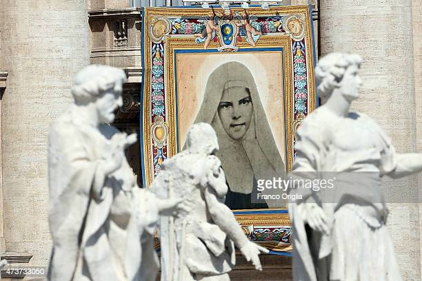 A tapestry featuring the portrait of the new Saint St Mary of Jesus Crucified is draped from the balcony overlooking St Peter's Square as Pope...