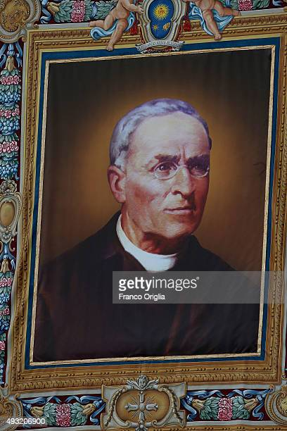 A tapestry featuring the portrait of the new Saint Vincent Grossi is draped from the balcony overlooking St Peter's Square as Pope Francis holds a...