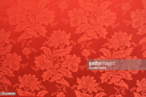 tapestry with a red colored ornate pattern - ドレープ ストックフォトと画像