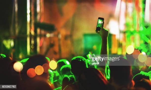 taping a concert show. - photo messaging stock pictures, royalty-free photos & images