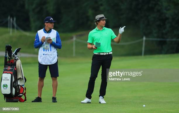 Tapio Pulkkanen of Finland and hsi caddie in discussion on the 7th hole during day one of the 2018 Shot Clock Masters at Diamond Country Club on June...
