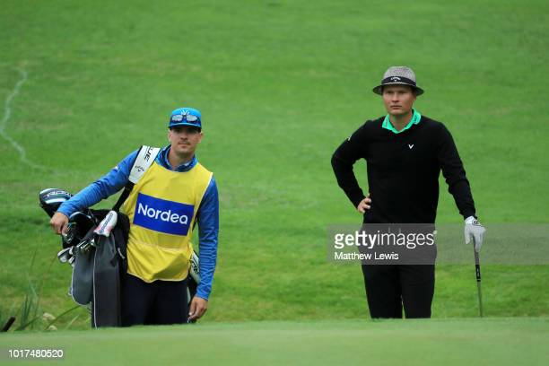 Tapio Pulkkanen of Finland looks on with his caddy on the 12th hole during Day One of Nordea Masters at Hills Golf Sports Club on August 16 2018 in...