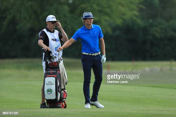 Tapio Pulkkanen of Finland looks on with his caddy on the 16th fairway during day two of The 2018 Shot Clock Masters at Diamond Country Club on June...