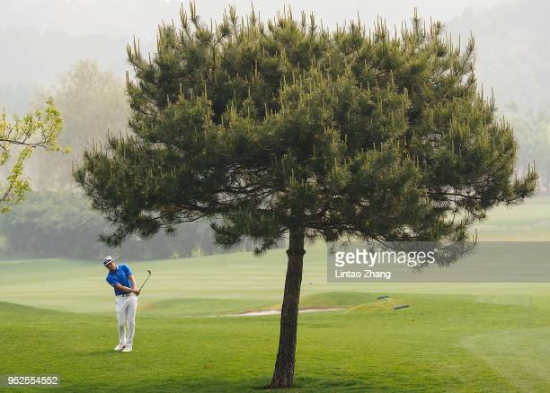 Tapio Pulkkanen of Finland plays a shot during the final round of the 2018 Volvo China Open at Topwin Golf and Country Club on April 29 2018 in...