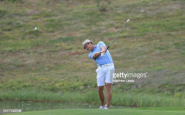 Tapio Pulkkanen of Finland plays his second shot from the 18th rough during a practice round ahead of the Nordea Masters at Hills Golf Club on August...