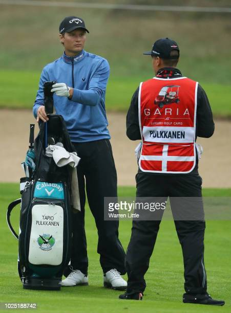 Tapio Pulkkanen of Finland speaks to his caddy on the 14th hole during day one of the Made in Denmark played at the Silkeborg Ry Golf Club on August...