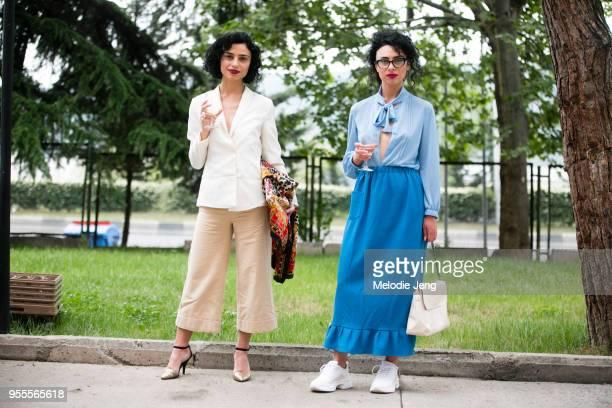 Tapo Shotadze wears tan Materiel by Lado Bokuchava pace pants Dana wears a blue Lado Bokuchava top white Celine shoes and white bag at MercedesBenz...
