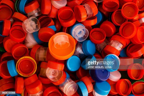 tapones - lid stock photos and pictures