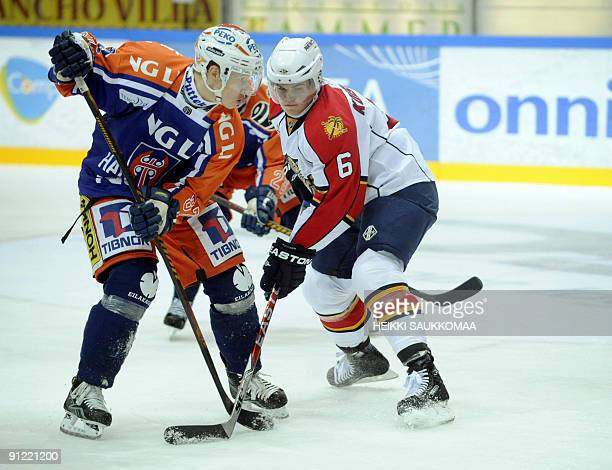 Tappara's Tomi Peltonen and Panthers' Ville Koistinen fight for the puck during the NHL Premiere Challenge game Tappara vs Florida Panthers in...