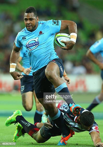 Taqele Naiyaravoro of the Waratahs breaks through a tackle during the round two Super Rugby match between the Rebels and the Waratahs at AAMI Park on...