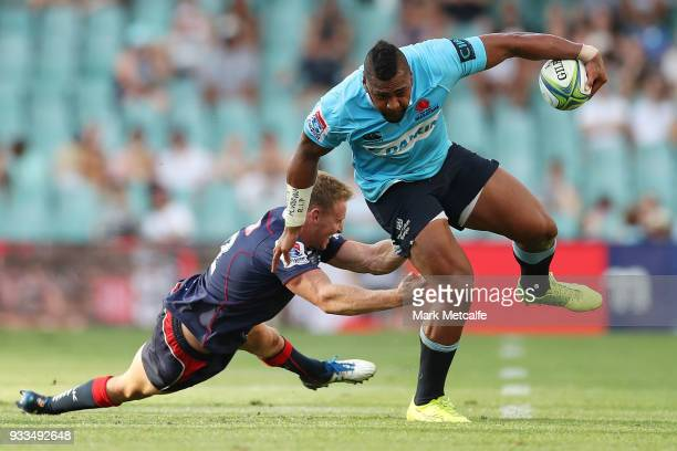 Taqele Naiyaravoro of the Waratahs evades the tackle of Reece Hodge of the Rebels action during the round five Super Rugby match between the Waratahs...
