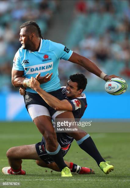 Taqele Naiyaravoro of the Waratahs is tackled by Jack Debreczeni of the Rebels during the round five Super Rugby match between the Waratahs and the...