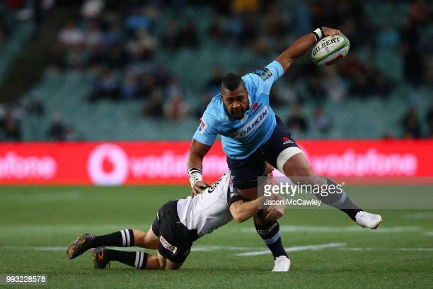 Taqele Naiyaravoro of the Waratahs is tackled during the round 18 Super Rugby match between the Waratahs and the Sunwolves at Allianz Stadium on July...