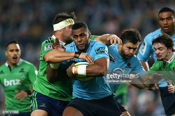 Taqele Naiyaravoro of the Waratahs is tackled during the Super Rugby Semi Final match between the Waratahs and the Highlanders at Allianz Stadium on...