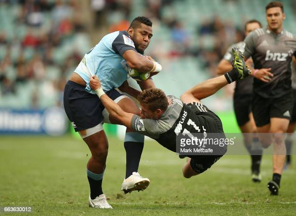 Taqele Naiyaravoro of the Waratahs runs through the tackle of George Bridge of the Crusaders to score a try during the round six Super Rugby match...