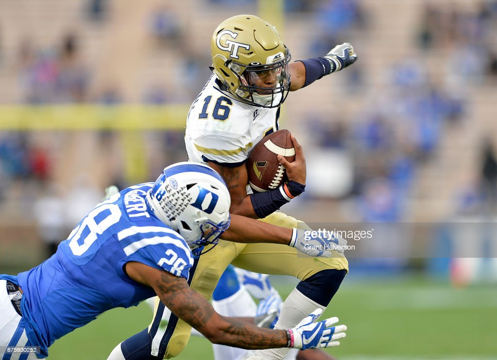 TaQuon Marshall #16 of the Georgia Tech Yellow Jackets avoids Mark Gilbert #28 of the Duke Blue Devils during their game at Wallace Wade Stadium on November 18, 2017 in Durham, North Carolina.