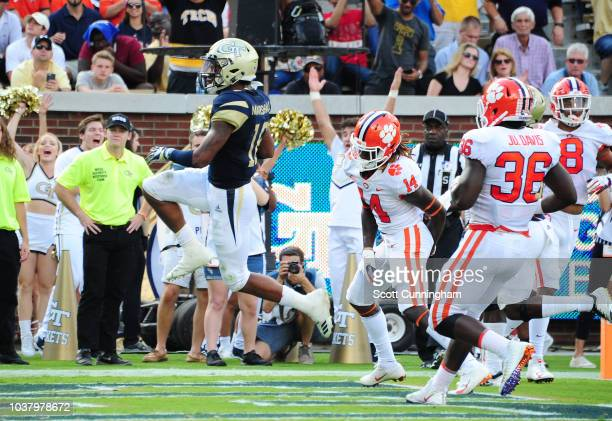 TaQuon Marshall of the Georgia Tech Yellow Jackets carries the ball against Clelin Ferrell of the Clemson Tigers on September 22 2018 in Atlanta...