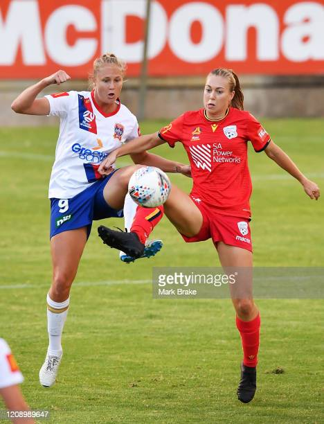 Tara Andrews of Newcastle Jets competes with Matilda McNamara of Adelaide United during the round 14 W-League match between Adelaide United and the...