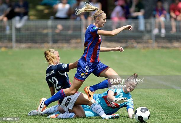 Tara Andrews of the Jets shoots for goal saved by Brianna Davey of the Victory during the round 10 WLeague match between the Newcastle Jets and...