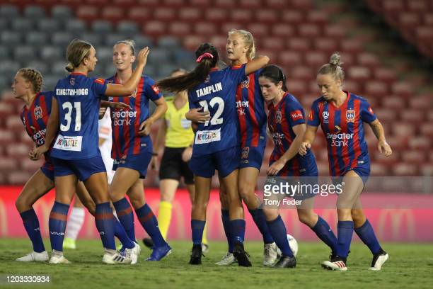 Tara Andrews of the Newcastle Jets celebrates a goal with team mates during the round nine W-League match between the Newcastle Jets and Adelaide...