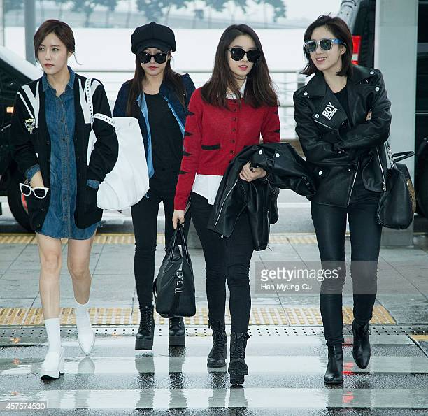 Tara are seen on departure at Incheon International Airport on October 21 2014 in Incheon South Korea