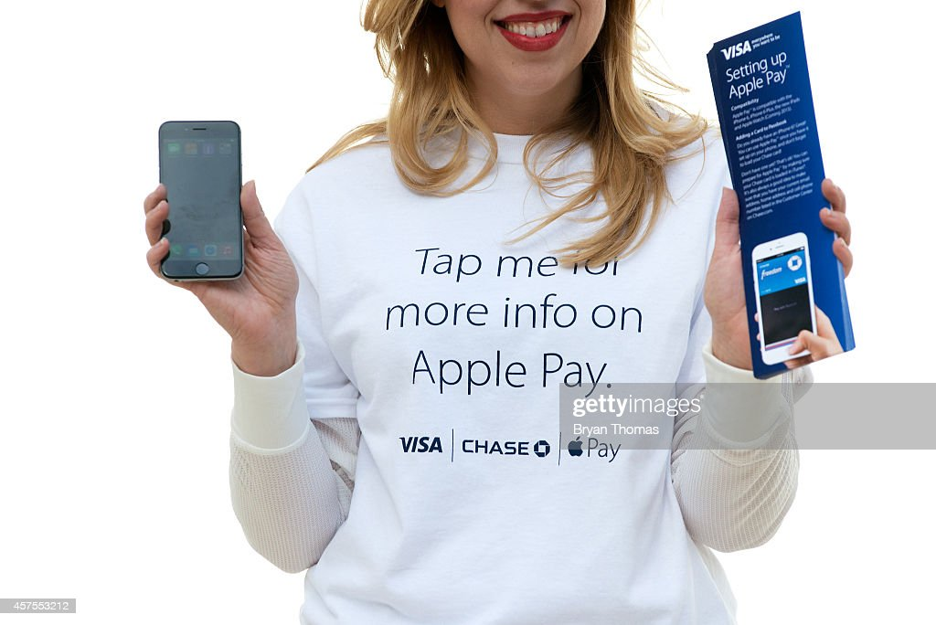 Tara Bruno teaches New York pedestrians how to use Apple Pay, as part of a Visa/Chase promotion, on October 20, 2014 in New York, NY. The software, which debuted today, is available in the recently updated iPhone 6 software and accepted in 220,000 stores. It allows iPhone users to pay for purchases using their iPhone's NFC capabilities instead of using their credit card.