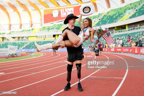 Tara Davis, second place in the Women's Long Jump Final, celebrates with boyfriend and Paralympian Hunter Woodhall on day nine of the 2020 U.S....