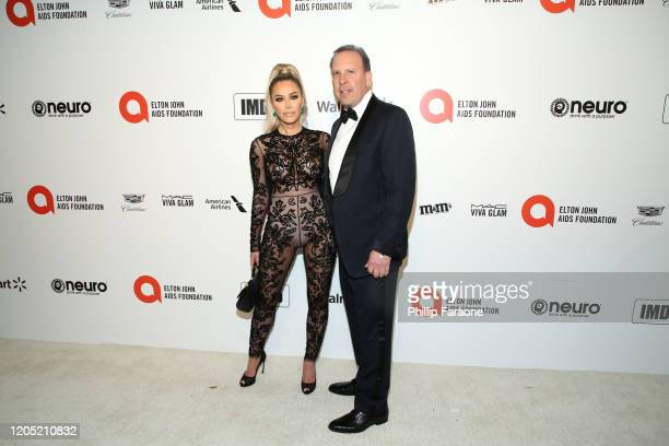 Tara Dollinger and Dave Dollinger attend the 28th Annual Elton John AIDS Foundation Academy Awards Viewing Party Sponsored By IMDb Neuro Drinks And...
