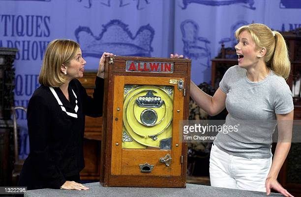 Tara Finley left an appraiser on Chubb''s Antiques Roadshow television show tells Sue Dale that her penny arcade machine from the 1920''s is worth...
