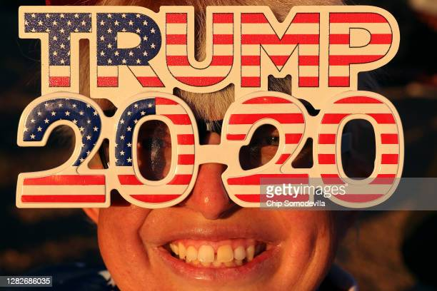 Tara Immen of Happy Valley, Arizona, wears decorative glasses while waiting in line to attend a campaign rally with U.S. President Donald Trump at...