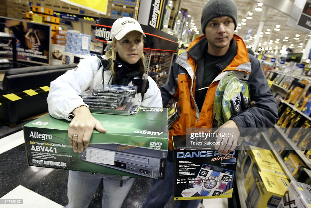 Tara Jackson and Tim Burnette both of Hebron, Indiana, wait at the checkout line inside a Best Buy electronics store November 26, 2004 in Hobart, Indiana. The Friday after Thanksgiving, called 'Black Friday,' is one of the busiest shopping days of the year with stores opening early and a large number of sales available to shoppers looking for holiday gifts.